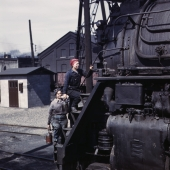 Women Railroad Workers Clean Giant Locomotive