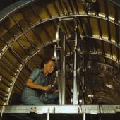 Worker Installs Oxygen Racks Above Flight Deck