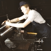 War Production Worker Checks M7 Gun With Gage