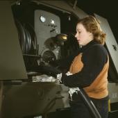 Woman War Worker Checks Gasoline Trailer Hoses