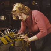 Woman Works on Black-Out Lamps for Gas Trailers