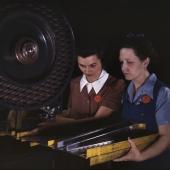 Workers Punch Rivet Holes in Bomber Frame Members