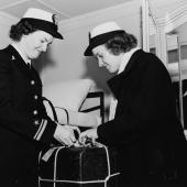 WAVES Officers Unpacking En Route To Hawaii