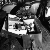 Navy Flight Nurse Checks Over Medical Kit