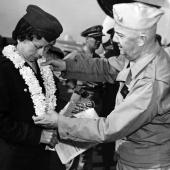Former POW Navy Nurse Receiving Lei from Captain