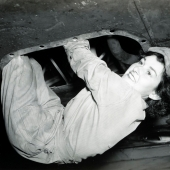 WAC Aircraft Mechanic Hanging From B-17 Wing