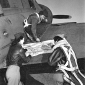 Three WASPs Check Flight Plan Before Tow Mission