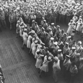 WAVES Kiss Sailors Goodbye on USS Saratoga