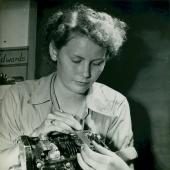 Woman Marine Works on Carburetor