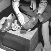 Woman Marine Polishing her Shoes