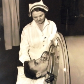 Navy Nurse Tends to Sailor in an Iron Lung