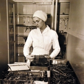 Navy Nurse Picking Instruments for Operation