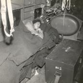 Navy Flight Nurse Naps on Flight from Iwo Jima