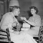 WAAC Lieutenant Lights Cigar for Her Father