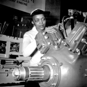 Navy WAVE Inspects a Grumman Wildcat Engine