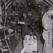 Flight Nurse Serves Fruit Juice to Air Evac Patients