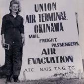 Navy Flight Nurse with Air Terminal Okinawa Sign