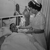 WWII Hospital Ship Nurse Feeds Patient Ice Cream
