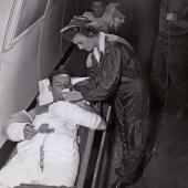 Navy Flight Nurse Tends to Patient Aboard Plane
