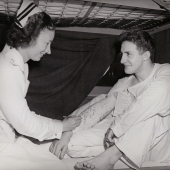 Navy Nurse Signs Sailor's Arm Cast