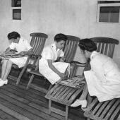 Nurses Read and Play a Game on Hospital Ship