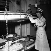 Nurse Takes Pulse of Patient on Hospital Ship