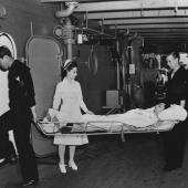 Nurse Watches Wounded Being Brought Aboard Ship