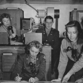 WACs Give Directions to Bombers Returning from Missions