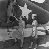 Army Flight Nurses Boarding Transport Plane