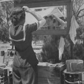Army Nurse Fixing Hair in Outdoor Mirror