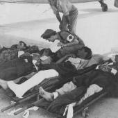 Flight Nurse Prepares Wounded for Transport